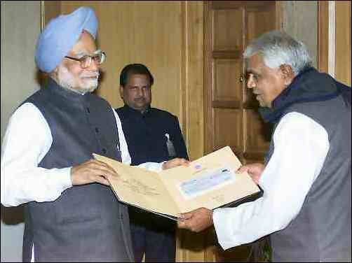 Babu Lal Gaur presenting cheque for the Prime Minister Relief Fund
